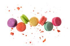 Flat lay. Close up. Sweet french macarons isolated on white background. Colorful macaroons flying or falling in motion