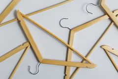 Flat lay of coat hangers on grey background Royalty Free Stock Photos