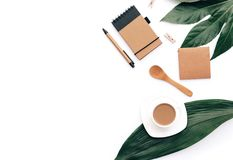 Flat lay coffee with eco craft items and green leaf. Minimal hipster concept. Office desk royalty free stock photography