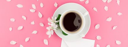 Flat lay of coffee, letter mockup and white petals Royalty Free Stock Photo