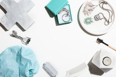 Flat lay collection of beauty and pamper objects. Flat lay collection of aqua and white beauty and pamper objects royalty free stock image