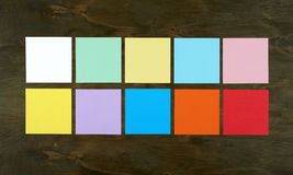 Flat lay color bar from paper on wood background. Flat design and top view of interface concept on desk. Royalty Free Stock Image