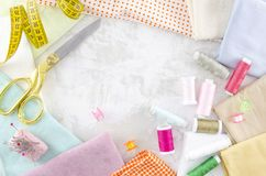 Flat lay colorful tailoring objects on a white background. Space for banner text.  stock photo