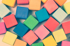 Flat lay of colorful wooden toy bricks Royalty Free Stock Images