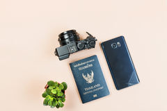 Flat lay of compact camera with Thailand official passport. Flat lay and copy space for design work of vintage digital compact camera with Thailand official royalty free stock photo