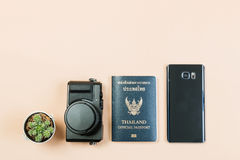 Flat lay of compact camera with Thailand official passport. Flat lay and copy space for design work of vintage digital compact camera with Thailand official royalty free stock photos