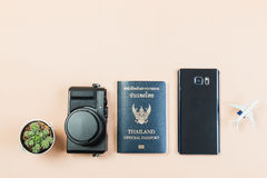 Flat lay of compact camera with Thailand official passport Stock Photos
