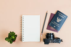 Flat lay of compact camera with Thailand official passport. Flat lay empty book and pencil for design work with vintage digital compact camera, Thailand official stock photo
