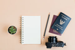 Flat lay of compact camera with Thailand official passport. Flat lay empty book and pencil for design work with vintage digital compact camera, Thailand official stock image