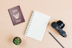 Flat lay of compact camera with Thailand passport. Flat lay empty book and pencil for design work with vintage digital compact camera, Thailand passport and stock photo