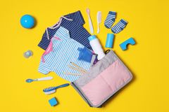 Flat lay composition with baby accessories and maternity bag. On color background royalty free stock images