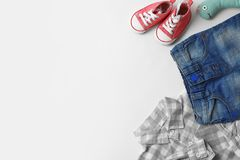 Flat lay composition with baby clothes, accessories and space for text. On white background royalty free stock photography