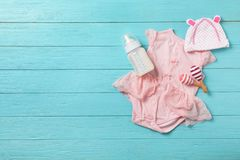 Flat lay composition with baby clothes. And accessories on wooden background. Space for text stock photography