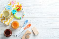 Flat lay composition with baby food and accessories stock photo