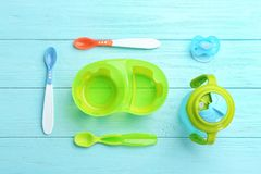 Flat lay composition with baby tableware for food. On wooden background royalty free stock images