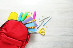 Flat lay composition with backpack, school stationery space for text on light background. Flat lay composition with backpack, school stationery and space for royalty free stock photo