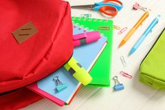 Flat lay composition with backpack and school supplies stock image