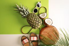 Flat lay composition with bamboo bag and beach items. On color background royalty free stock photo
