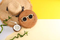 Flat lay composition with bamboo bag, beach items and space for text. On color background royalty free stock photo