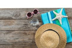 Flat lay composition with beach accessories on wooden background. Space for text stock image