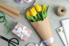 Flat lay composition with beautiful blooming tulip flowers and accessories stock image