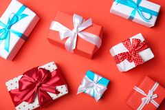 Flat lay composition with beautiful gift boxes. On color background Stock Images