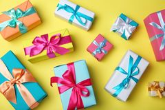 Flat lay composition with beautiful gift boxes. On color background Stock Image