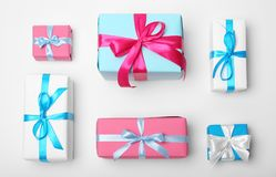 Flat lay composition with beautiful gift boxes. On white background Royalty Free Stock Images