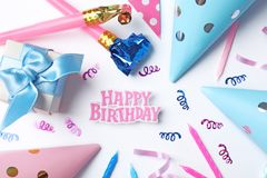 Beautiful flat lay composition with birthday party items on light background. Flat lay composition with birthday party items on light background Royalty Free Stock Photography