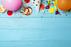 Flat lay composition with birthday party items. On wooden background stock image