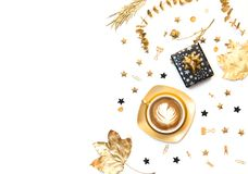 Flat lay composition for bloggers. Gold coffee cup with present and decorations stock image