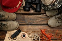 Flat lay composition with camping equipment. On wooden background royalty free stock image