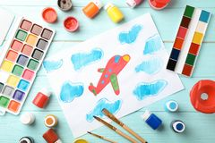 Flat lay composition with child`s painting stock photography
