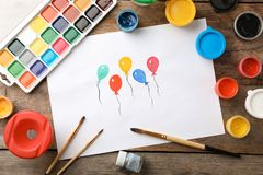 Flat lay composition with child`s painting of balloons