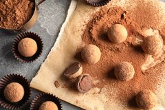 Flat lay composition with chocolate truffles. On grey background royalty free stock images