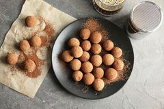 Flat lay composition with chocolate truffles. On grey background stock photos
