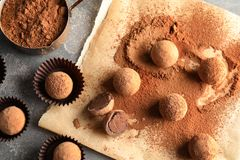 Flat lay composition with chocolate truffles. On grey background royalty free stock photography