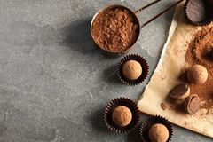 Flat lay composition with chocolate truffles on grey background. Space for text stock photo