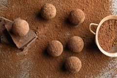 Flat lay composition with chocolate truffles powdered. With cacao on table stock images