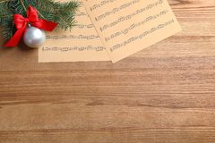 Flat lay composition with Christmas decorations and music sheets. On wooden background royalty free stock photography