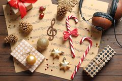 Flat lay composition with Christmas decorations, music sheets and headphones royalty free stock image