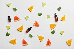 Flat lay composition with citrus essential oils. On light background stock photo