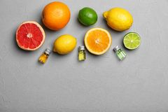 Flat lay composition with citrus essential oils. On grey background stock photos