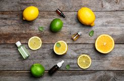 Flat lay composition with citrus essential oils. On wooden background royalty free stock photography