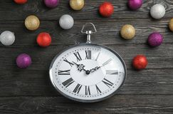 Composition with clock and decorations on wooden background. Christmas countdown Stock Photo
