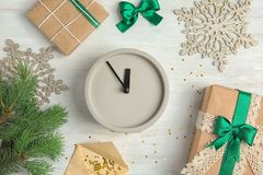 Composition with clock, gifts and decorations on wooden background. Christmas countdown Stock Images