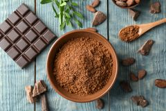 Flat lay composition with cocoa powder and chocolate bar stock photos