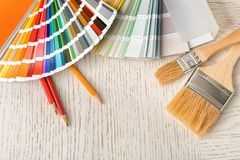 Flat lay composition with color palette and brushes. On table royalty free stock image