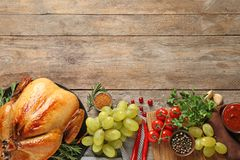 Flat lay composition with cooked turkey on wooden background. Space for text stock photography