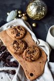 Chocolate chip cookies with piece of chocolate and christmas ball. View from the top royalty free stock photos